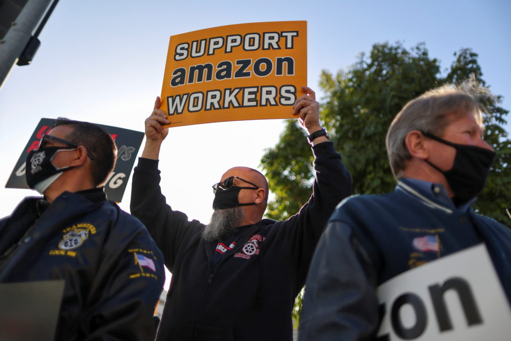 People protest in support of the unionizing efforts of the Alabama Amazon workers, in Los Angeles, California, U.S., March...
