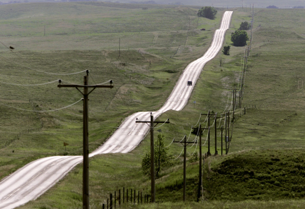 A road through green rolling hills