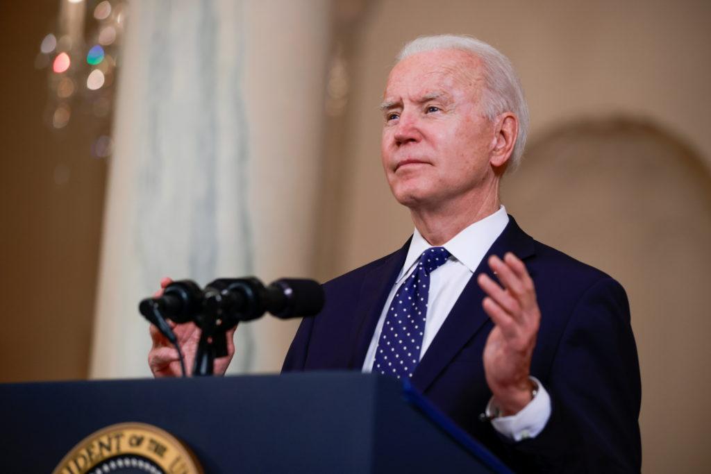 U.S. President Joe Biden speaks in the Cross Hall at the White House in Washington, U.S., April 20, 2021. Photo by Tom Bre...