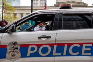 A police car is seen as people demonstrate outside of the Ohio Statehouse following this week's police shooting of 16-year-old Ma'Khia Bryant in Columbus, Ohio, U.S., April 24, 2021. Photo by REUTERS/Gaelen Morse