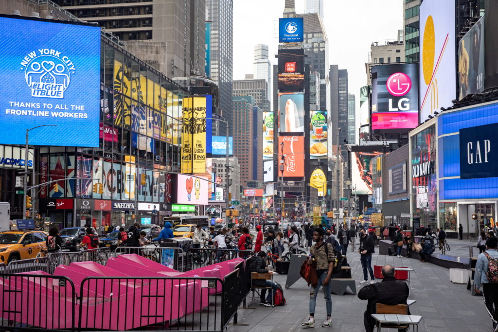 FILE PHOTO: People wearing protective masks are seen in Times Square during the outbreak of the coronavirus disease (COVID...