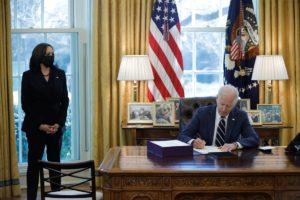 U.S. President Joe Biden signs the American Rescue Plan, a package of economic relief measures to respond to the impact of the coronavirus disease (COVID-19) pandemic, inside the Oval Office at the White House in Washington, U.S., March 11, 2021.