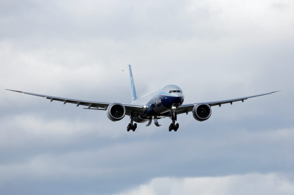 A Boeing 777X airplane flies above the Boeing Everett Factory after Boeing announced a temporary suspension of production operations at its Puget Sound area facilities, during the coronavirus disease (COVID-19) outbreak, in Everett, Washington, U.S. March 23, 2020. REUTERS/David Ryder