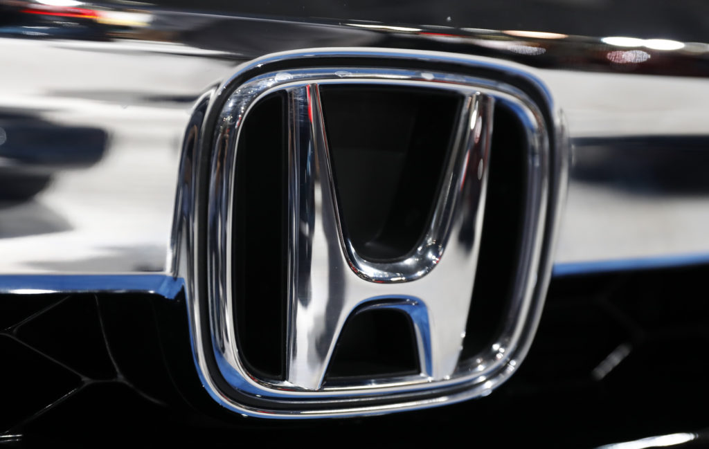 The Honda logo is seen on a Honda car at the New York Auto Show in New York
