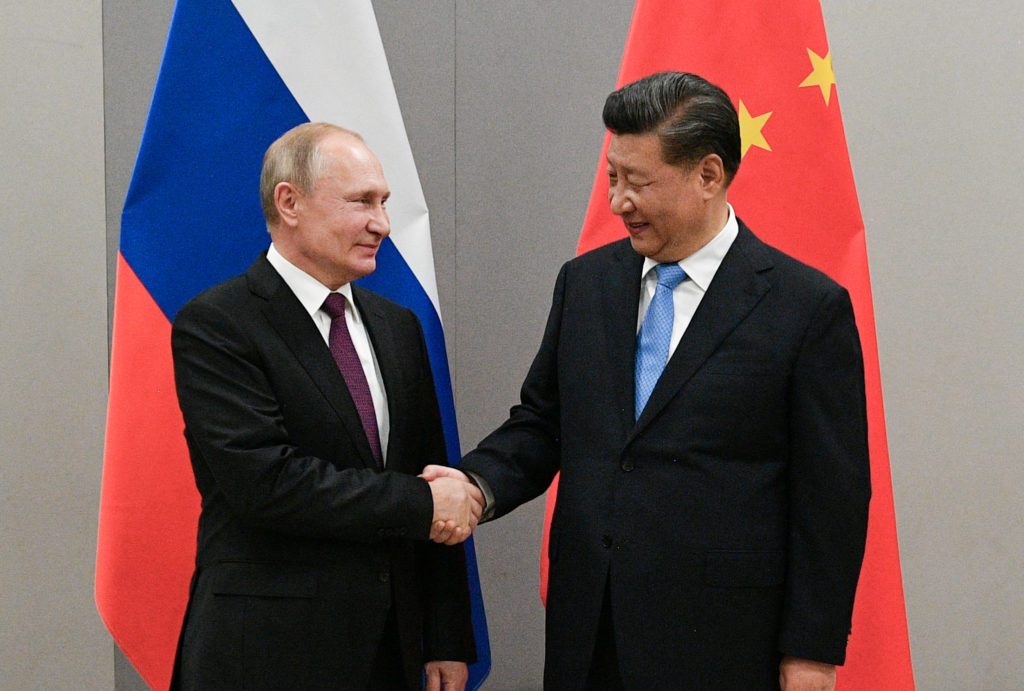 FILE PHOTO: Russian President Putin meets with Chinese President Xi during their meeting on the sideline of the BRICS summ...