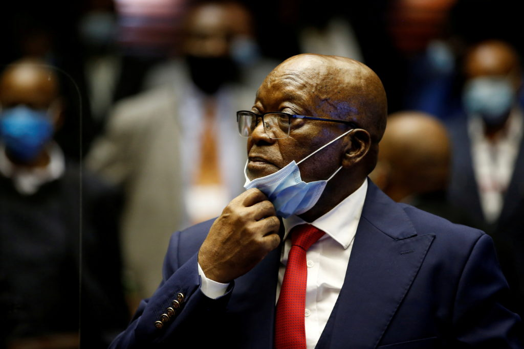 FILE PHOTO: Former South African President Jacob Zuma stands in the dock after recess in his corruption trial in Pietermar...