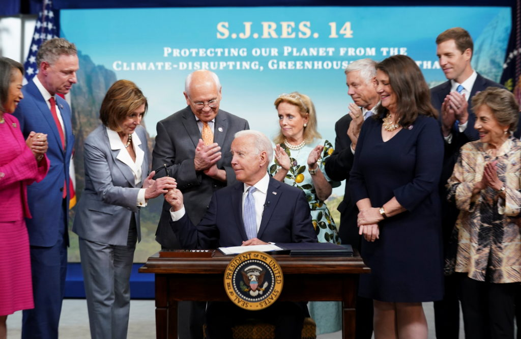 Biden signs bills into law at the White House in Washington