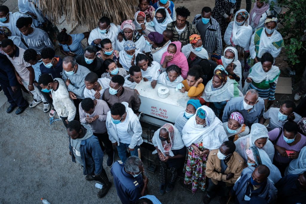 Relatives wait for the arrival of ambulances outside the Ayder referral hospital in Mekele, the capital of Tigray region, Ethiopia, on June 23, 2021, a day after a deadly airstrike on a market in Ethiopia's war-torn northern Tigray region, where a seven-month-old conflict surged again.
