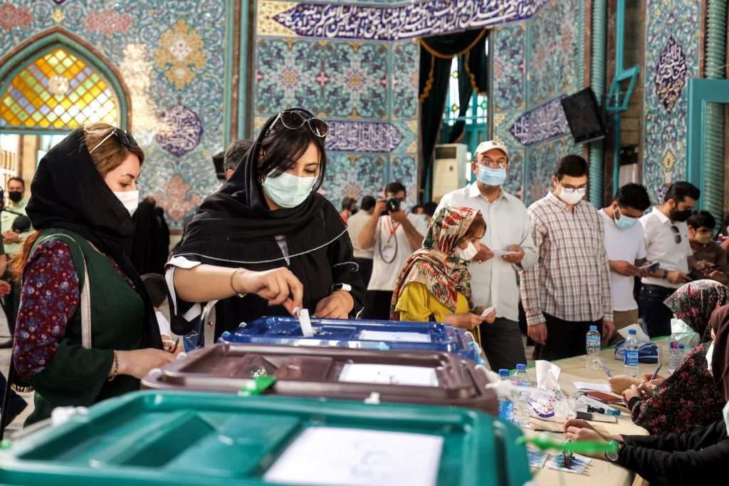 Iranians decry, boycott election tipped in hard-liner's favor by supreme leader