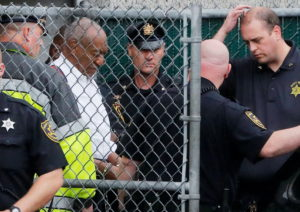 FILE PHOTO: Actor and comedian Bill Cosby leaves the Montgomery County Courthouse in handcuffs after sentencing in his sex...
