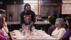 A group of people gather around a dinner table for a meal in the new documentary, 'High on the Hog'