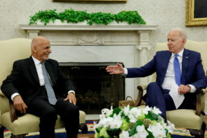 President Joe Biden talks with Afghan President Ashraf Ghani