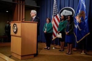 Attorney General Merrick Garland announces investigation into Georgia voting laws at a podium.