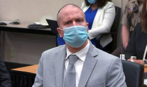 Derek Chauvin listens to a Minnesota judge hand down his sentence