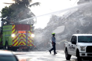 Emergency crews look through rubble of collapsed Florida apartment building