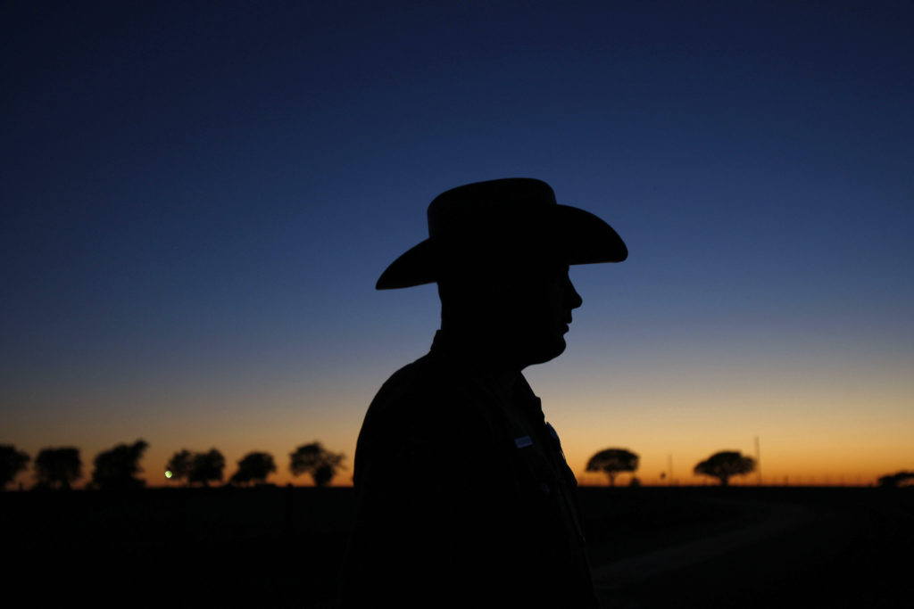Texas state trooper waits to escort U.S. President Bush in a motorcade in Texas