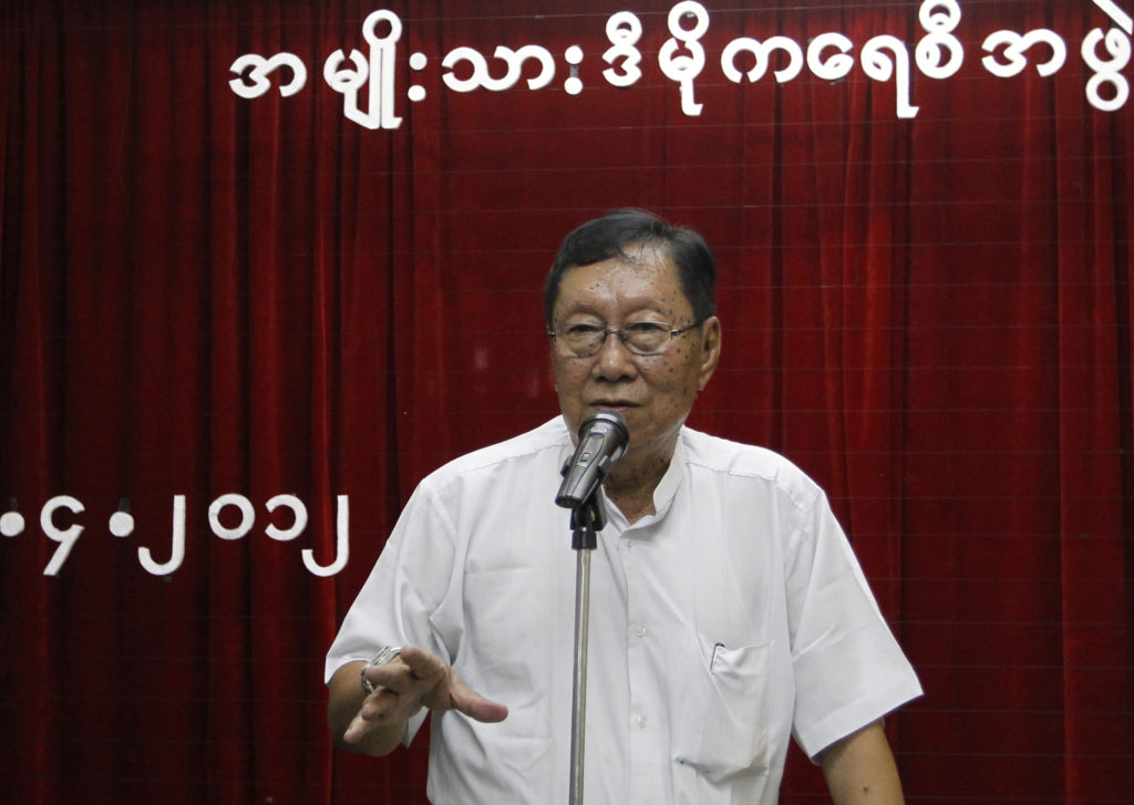 Top NLD official Nyan Win talks to reporters after a meeting at the party's head office in Yangon