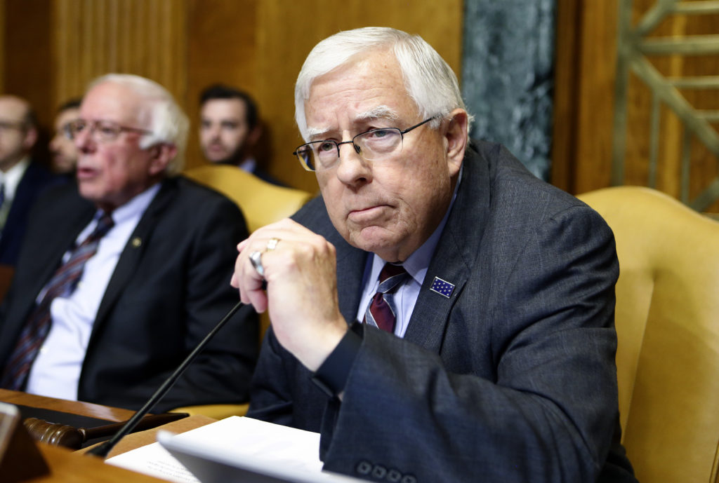 Chairman of the Senate Budget Committee Enzi waits for order to be restored during markup of the FY2018 Budget reconciliat...