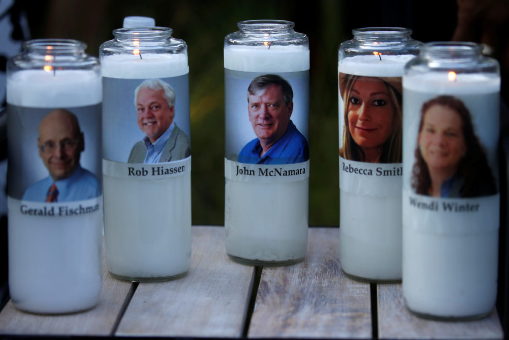 Candles representing the slain journalists of Capital Gazette sit on display during a candlelight vigil held near the Capi...
