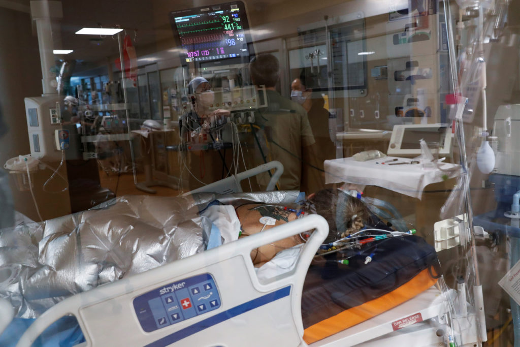 FILE PHOTO: A coronavirus disease (COVID-19) positive patient lies in a bed in the intensive care unit (ICU) at Sarasota M...