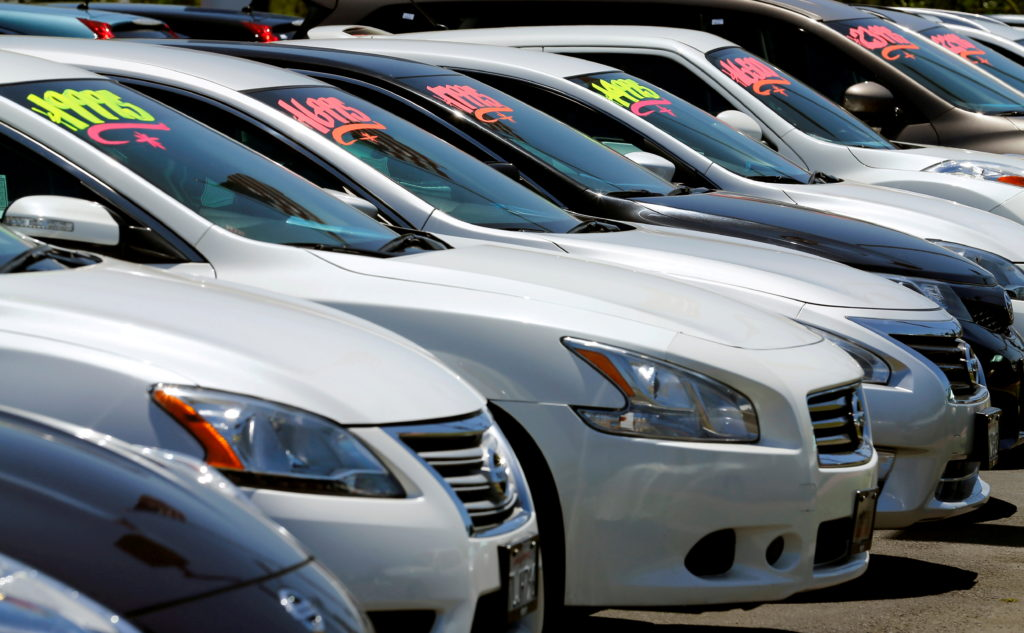 FILE PHOTO: Automobiles are shown for sale at a car dealership in Carlsbad, California