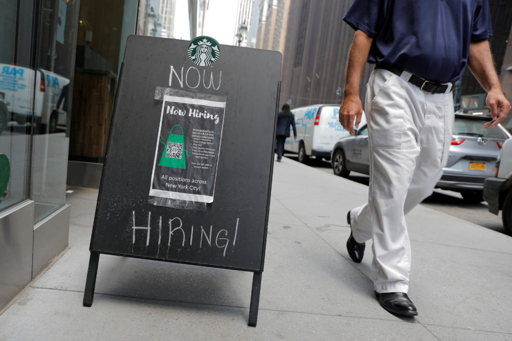 A sign advertising job openings is seen outside of a Starbucks in Manhattan, New York City, New York