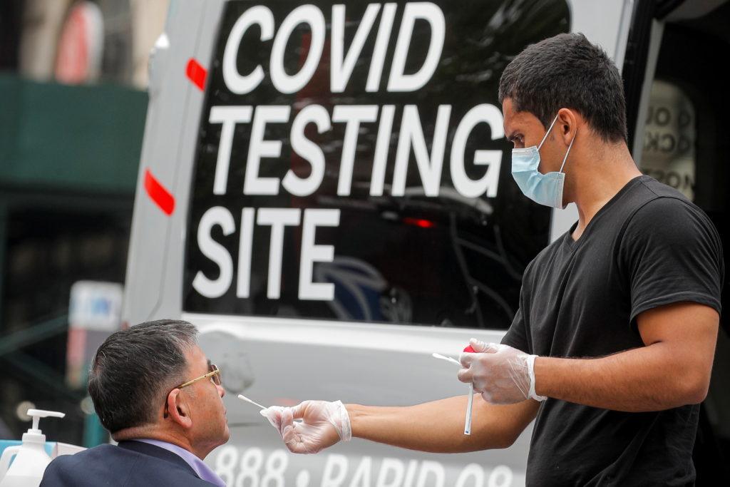A man receives a coronavirus disease (COVID-19) test at a mobile testing van in Brooklyn, New York