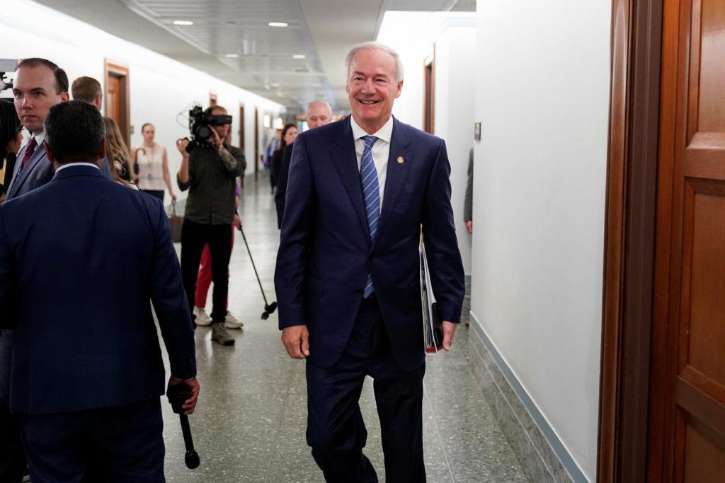 Arkansas Governor Asa Hutchinson walks through the Dirksen Senate office building in Washington