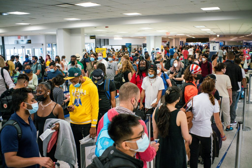 Travellers wait in line for immigration process ahead of the July 4th holiday, at the Newark Liberty International Airport...