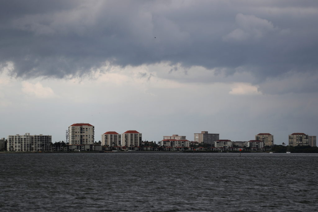 Dark clouds loom over the Pass-A-Grille channel ahead of Tropical Storm Elsa, in St. Petersburg
