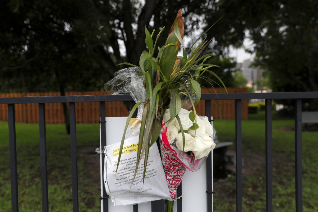 A makeshift memorial for the victims of the Surfside's Champlain Towers South condominium collapse sits in a park nearby i...