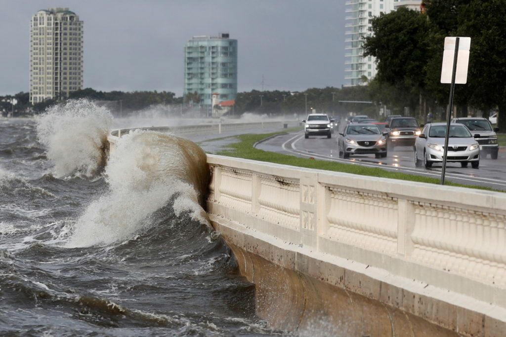 Waves crash against the balustrades after Hurricane Elsa churns up the Gulf coast, in Tampa