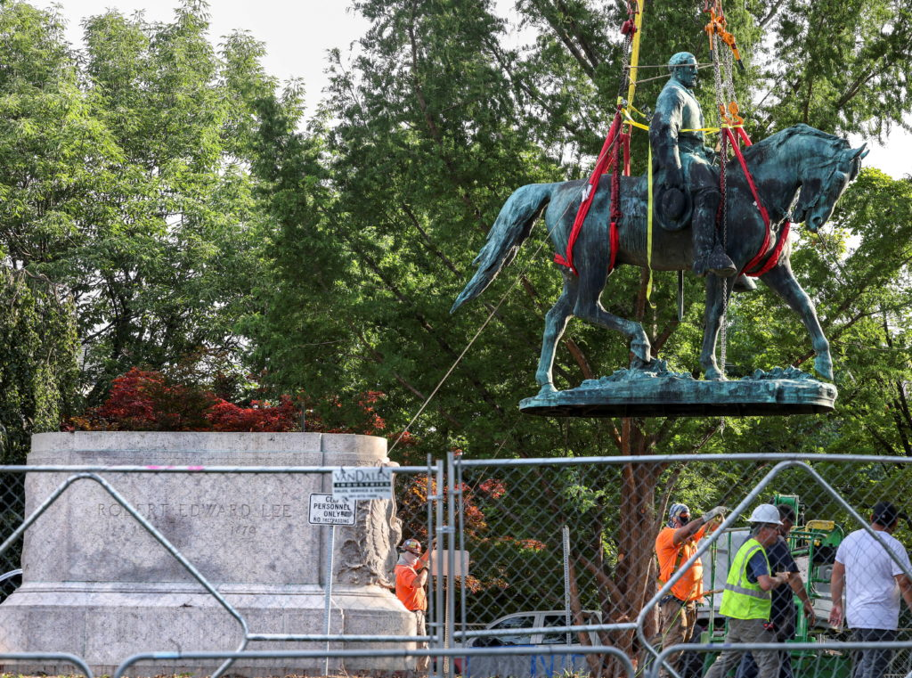 Workers remove a statue of Confederate General Robert E. Lee, in Charlottesville