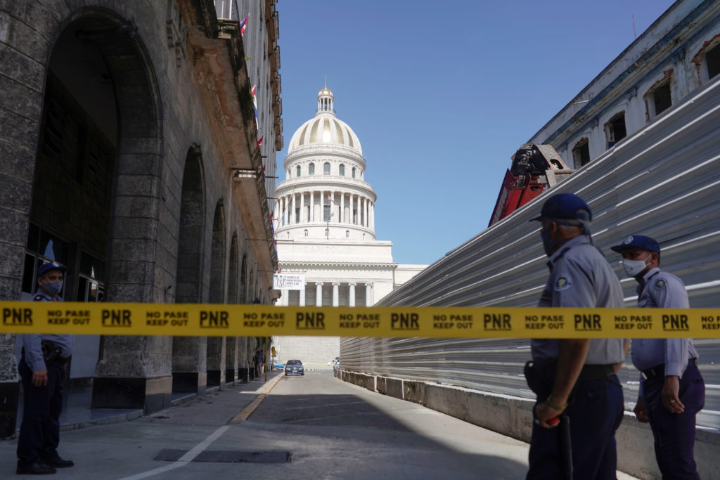 A police line is seen blocking a road leading to the National Capitol Building in Havana
