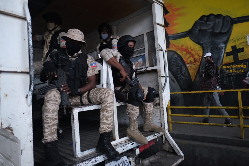 Haitian police patrol the streets as protests were planned after the assassination of President Jovenel Moise, in Port-au-...
