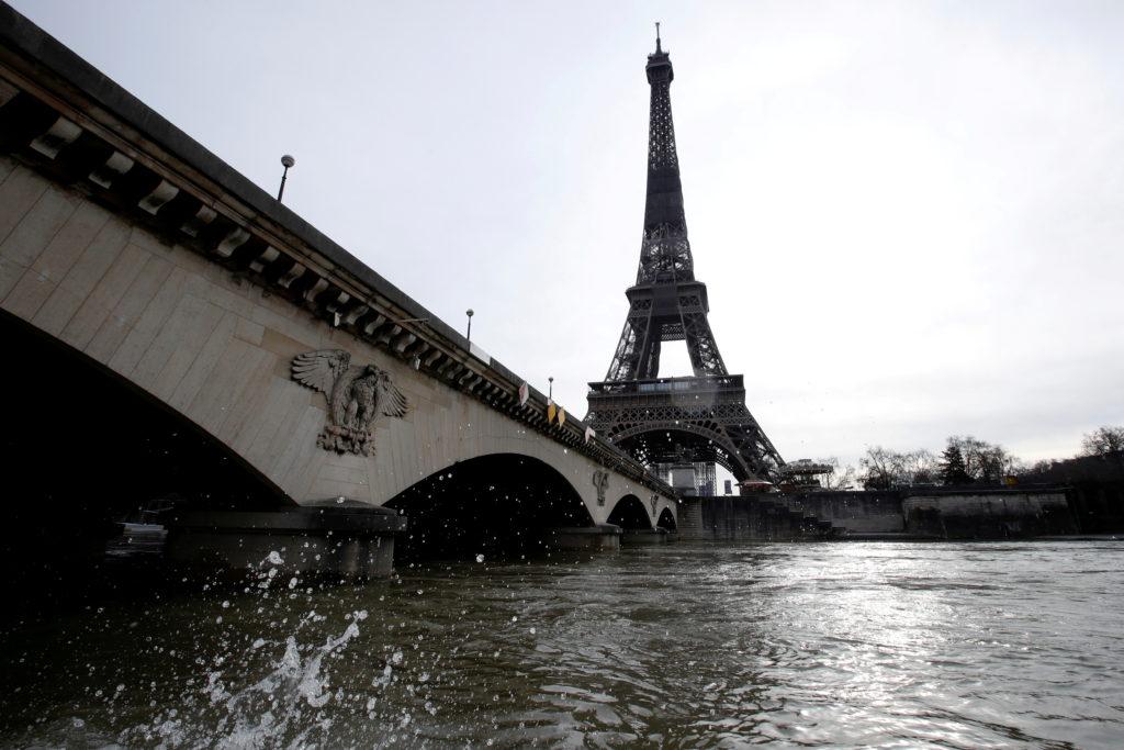 FILE PHOTO: Parisian firefighters patrol the river Seine in Paris