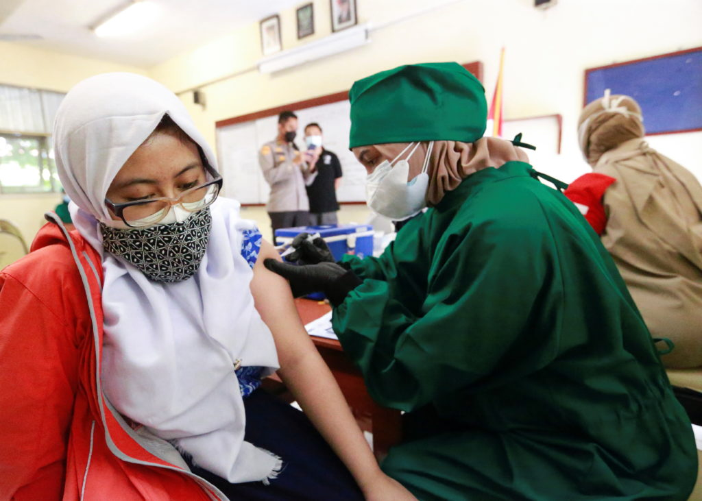 Mass vaccination program for students at a school in Jakarta