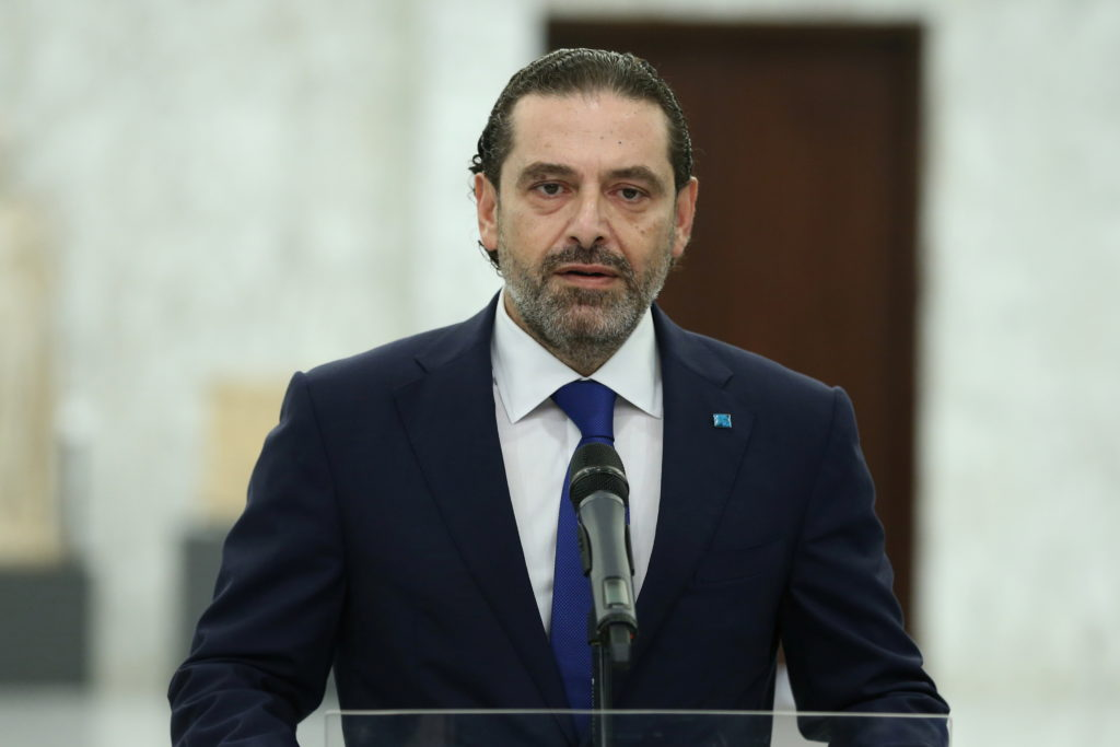 Lebanese Prime Minister-Designate Saad al-Hariri speaks as he abandons cabinet formation, at the presidential palace in Ba...