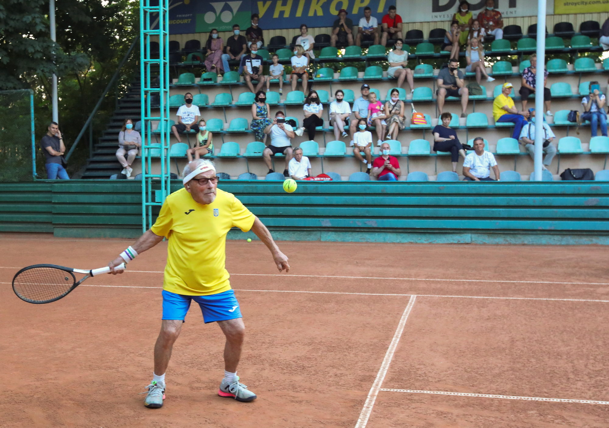 The world's oldest tennis player Ukrainian Stanislavskyi, 97, practices on court in Kharkiv