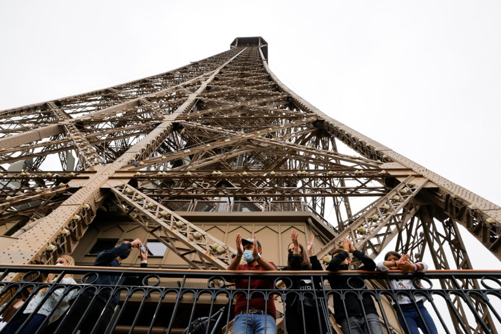 Paris' iconic Eiffel Tower reopens its doors to tourists