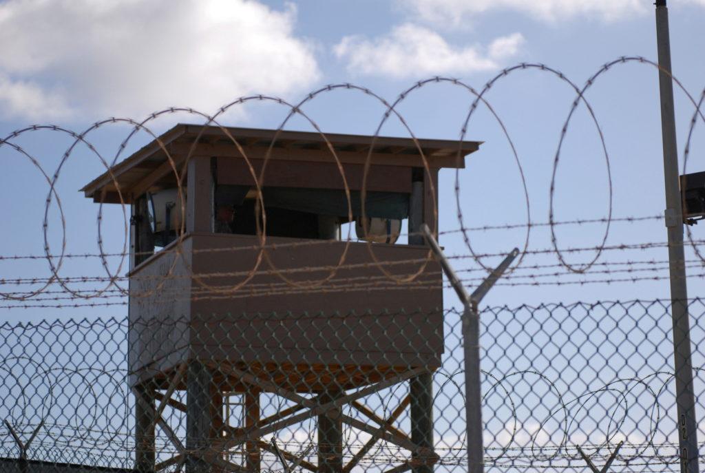 FILE PHOTO: FILE PHOTO: File photo of a soldier standing guard in a tower overlooking Camp Delta at Guantanamo Bay naval base