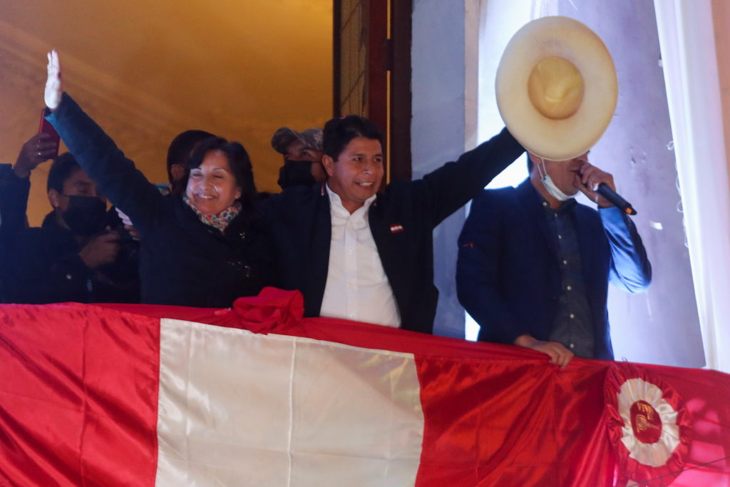 Leftist Pedro Castillo celebrates after Peru's electoral authority announced him as the winner of the presidential electio...