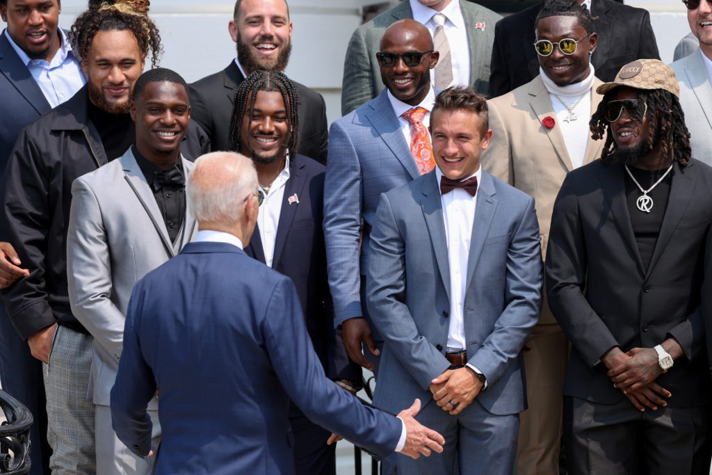 Members of the NFL football champion Tampa Bay Buccaneers react as U.S. President Biden arrives for a reception for the te...