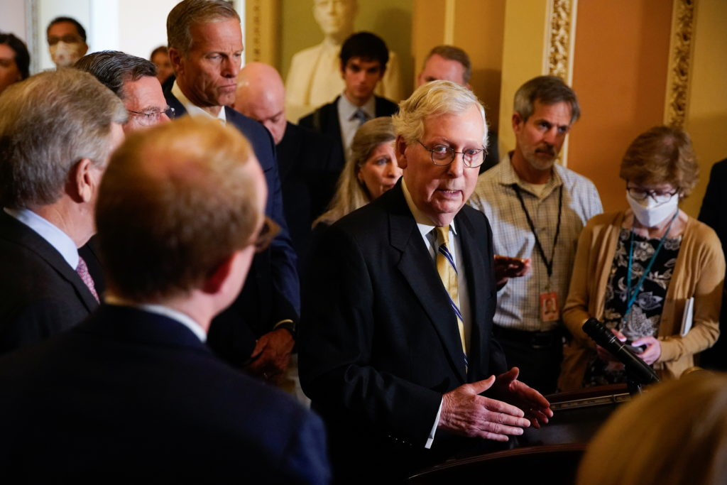 Senate Minority Leader Mitch McConnell speaks to reporters following a weekly Senate lunch on Capitol Hill