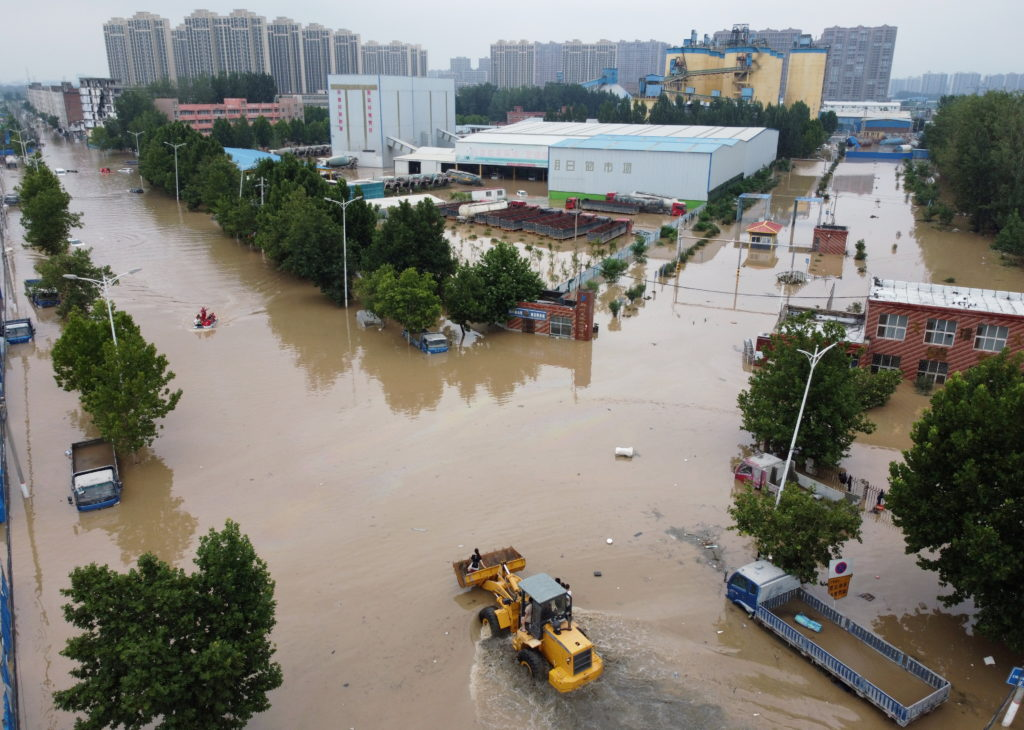FILE PHOTO: Aerial view shows rescue workers evacuating residents on a flooded road following heavy rainfall in Zhengzhou