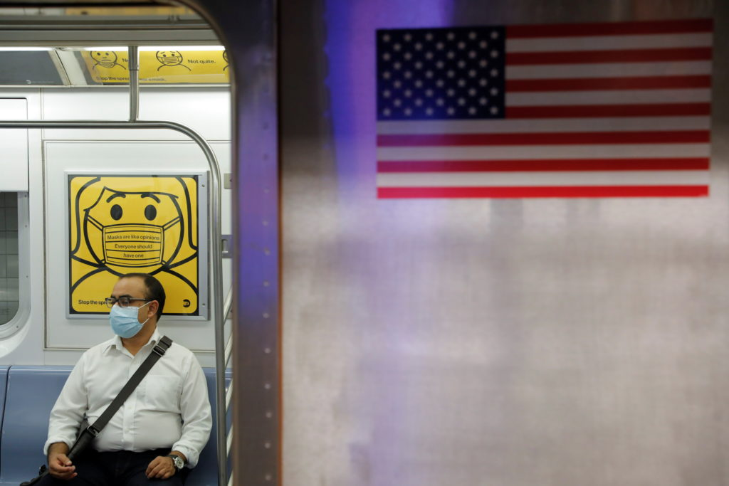 A commuter wears a mask while riding the subway as cases of the infectious coronavirus Delta variant continue to rise in N...