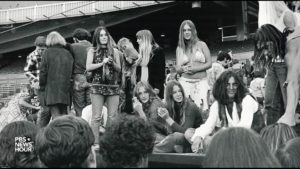 Young people sit around a circle in a black and white photograph