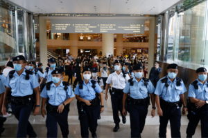 Police ask supporters to leave during the court hearing of Tong Ying-kit, the first person charged under a new national se...