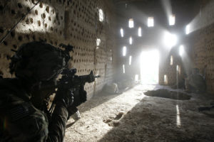 U.S. soldier points his rifle after coming under fire in Zharay district in Kandahar province, southern Afghanistan