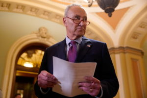 U.S. Senate Majority Leader Chuck Schumer (D-NY) looks down the hall after speaking to reporters following a weekly Senate...